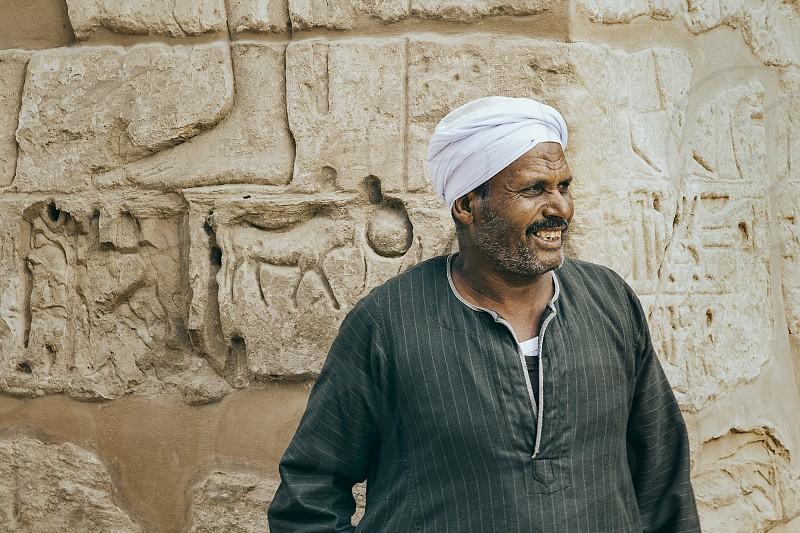 LUXOR EGYPT - December 9th: Karnak Temple Egypt worker on December 9th 2016 in LUXOR EGYPT photo