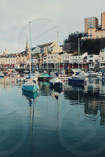 The Victorian harbour at Torquay Devon on a tranquil Summer's day. photo