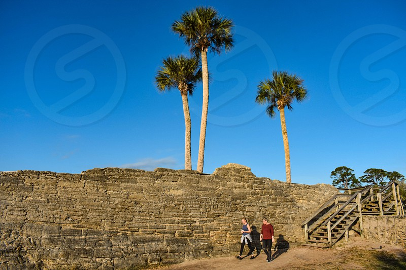 St. Augustine Florida. January 26  2019. Woman's walking in Castillo de San Marcos Fort area in Florida's Historic Coast . photo