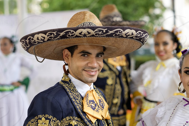 Male close up portrait. Puerto Vallarta Jalisco Mexico. Xiutla Dancers - a folkloristic Mexican dance group in traditional costumes representing the culture and different regions of Mexico. photo