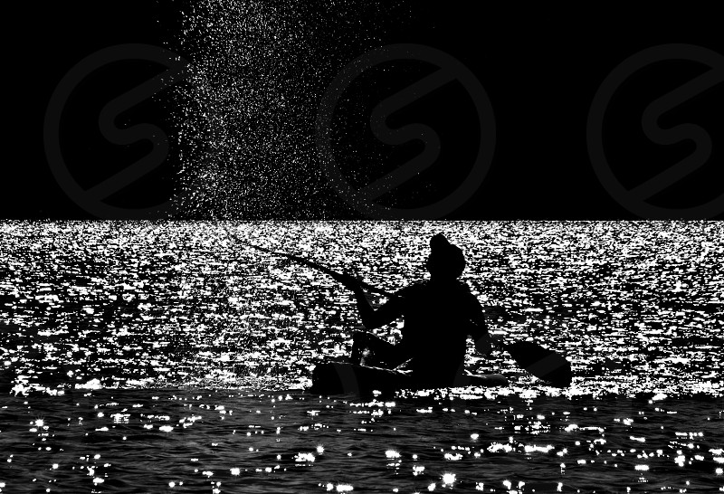 B&W image of a kayaker on an extremely hot day flicking water into the air to cool off. Lysterfield Lake Melbourne. photo