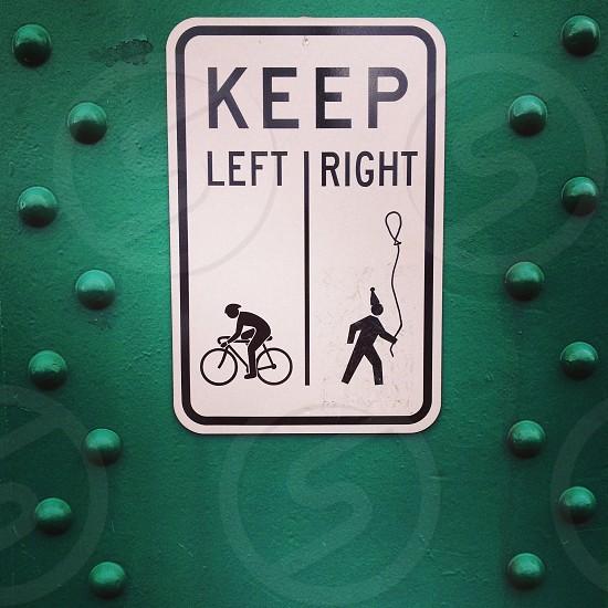 white and black Keep Left Right signage photo