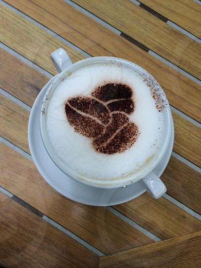 white ceramic mug with coffee photo