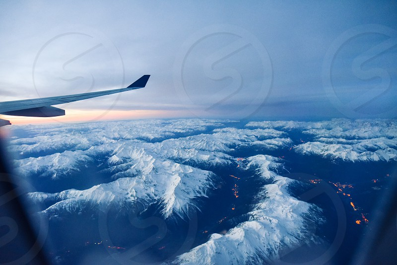fly plane wing alps italy ski winter mountains travel photo