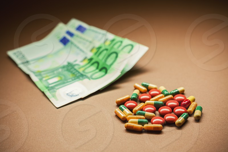 Conceptual composition representing a need for cure euro banknotes in blurry background.  photo
