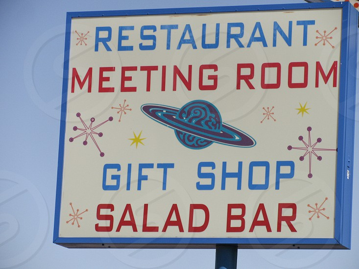 The outer space theme of the Space Age Lodge motel in Gila Bend Arizona includes planets and stars in its roadside advertising sign. 401 E. Pima St. near Interstate 10. photo