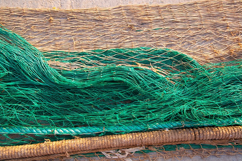 fishing nets texture pattern over soil in green and beige colors photo