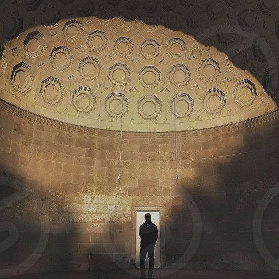 person standing inside dome structure photo