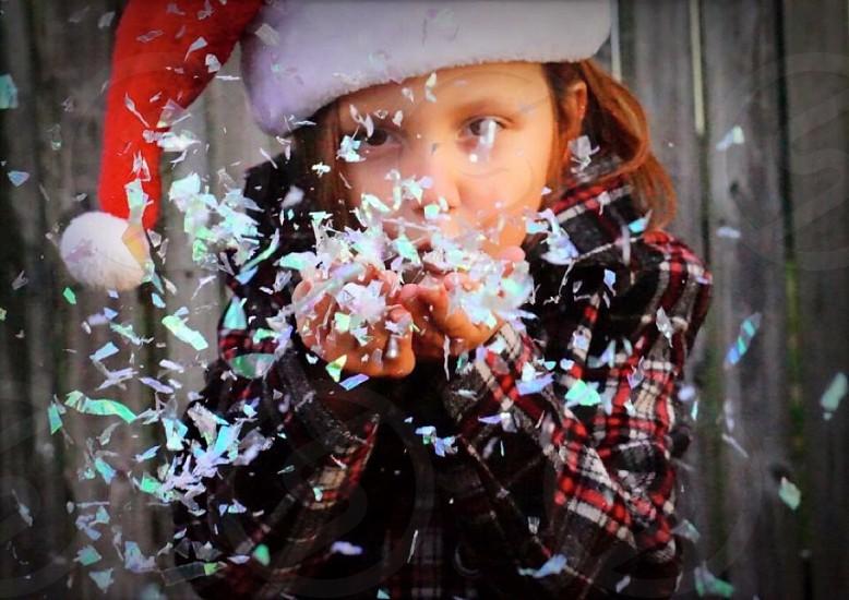 Holiday child Santa hat glitter snow flakes fun photo