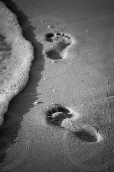 Footprints in the sand. photo