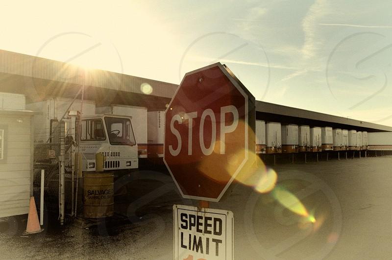 Image of many trucks parked at  a warehouse facility photo