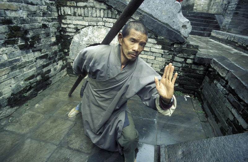 Shaolin monk at the Shaolin monestry in the town of Shaolin in the province of Henan in china in east asia.  photo