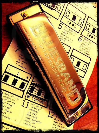 brown Bluesband harmonica in closeup photography photo