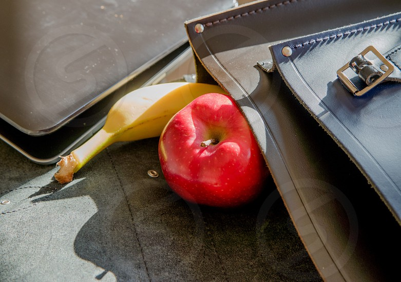 Lunch work office bag satchel Apple banana laptop computer business eat break food photo