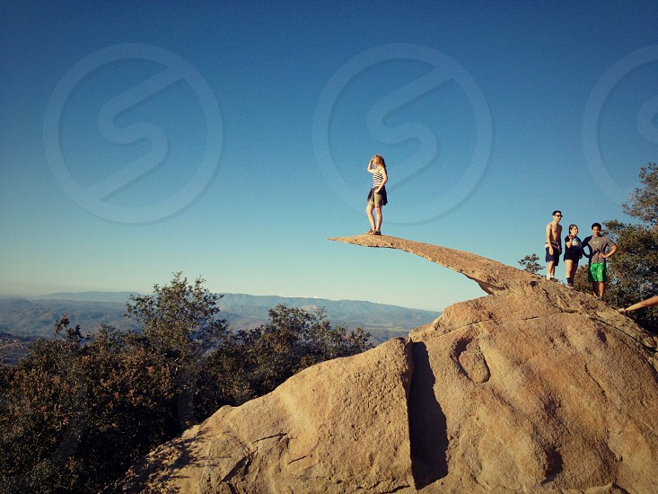 woman on cliff photography photo
