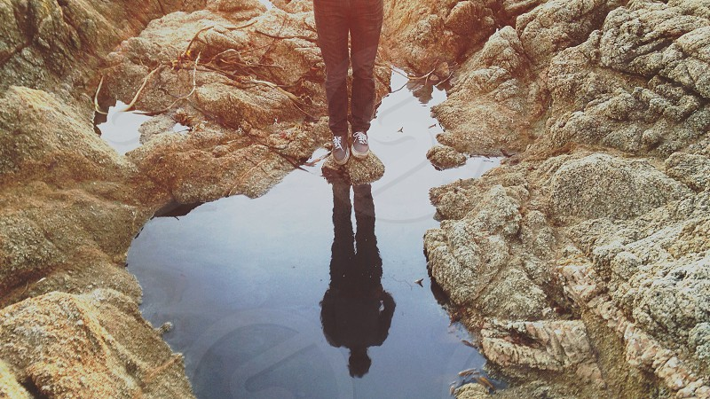 person standing on brown stone photo