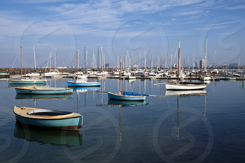 Colourful boats reflected in the calm waters of St. Kilda marina Melbourne. photo