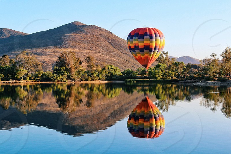 red and blue hot air balloon photo