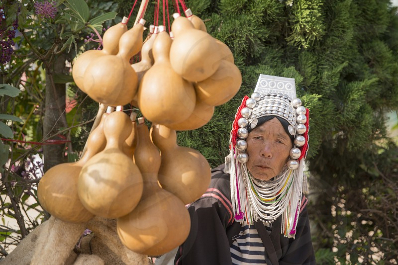 a Akha Hill Tribe women at the Market in the town of Mae Salong north of the city Chiang Rai in North Thailand. photo