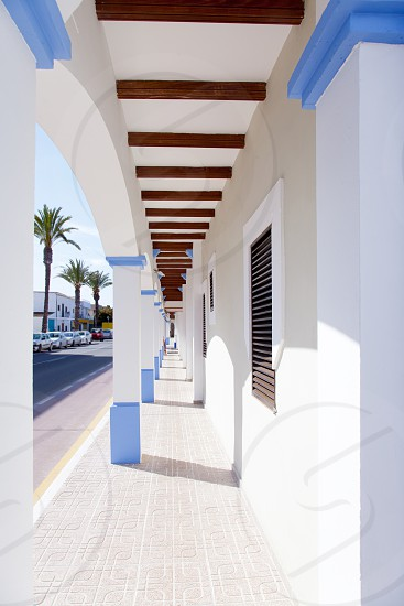 Balearic Formentera island La Savina narrow arcade in white houses  photo