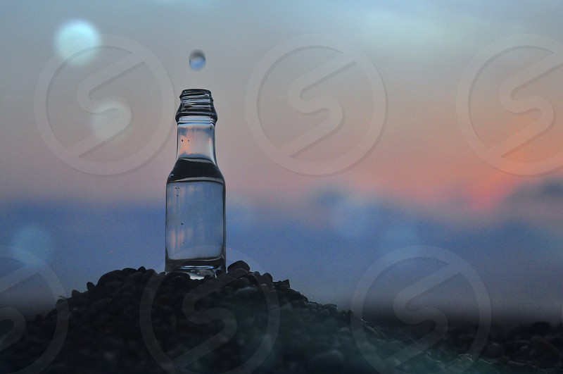 clear glass bottle filled with water photo