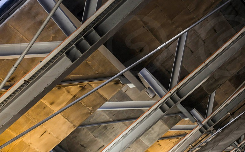 low angle photo of grey metal truss photo