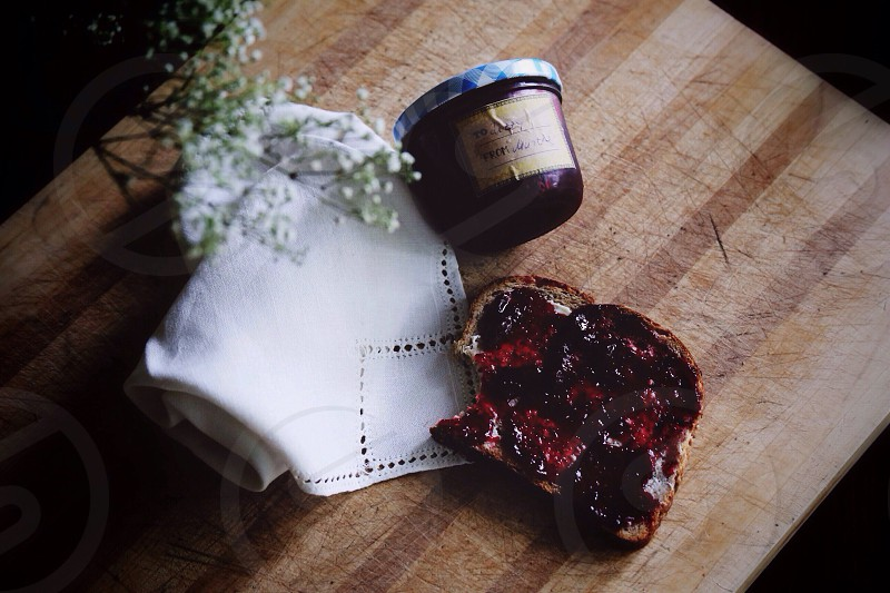 toasted bread beside white textile flower and jar photo