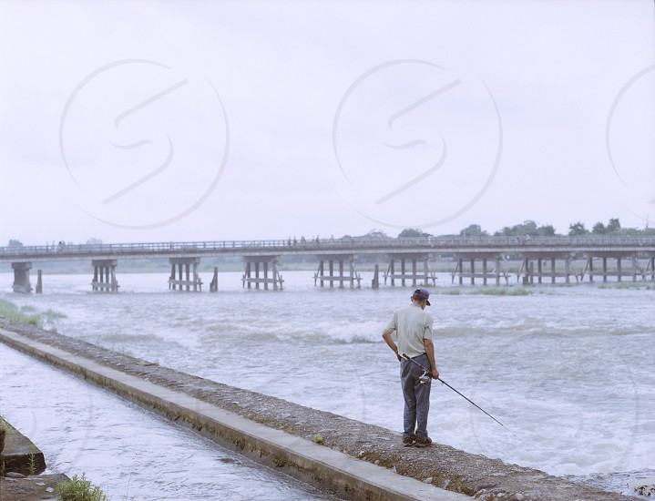 man in white t-shirt fishing photo