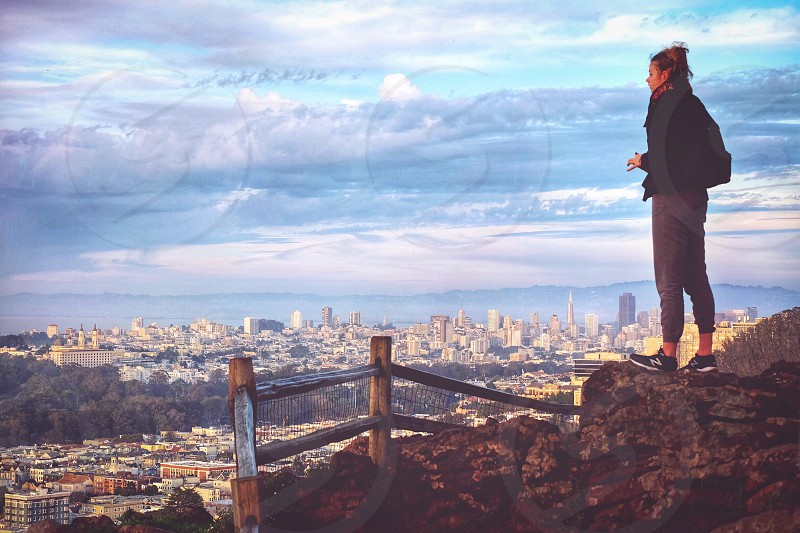 Portrait woman behind San Francisco overlook viewpoint city hiker view skyclouds photo