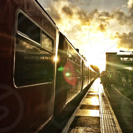 sunrise over train and beside walking beside photo