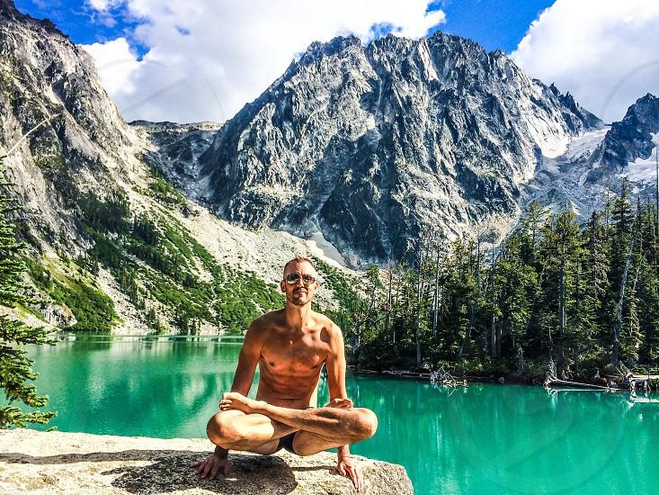 Lifted lotus yoga pose Colchuck lake.  photo