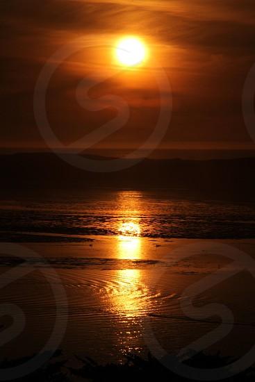 Sunset on the ocean.  ocean sea seashore sunset water photo