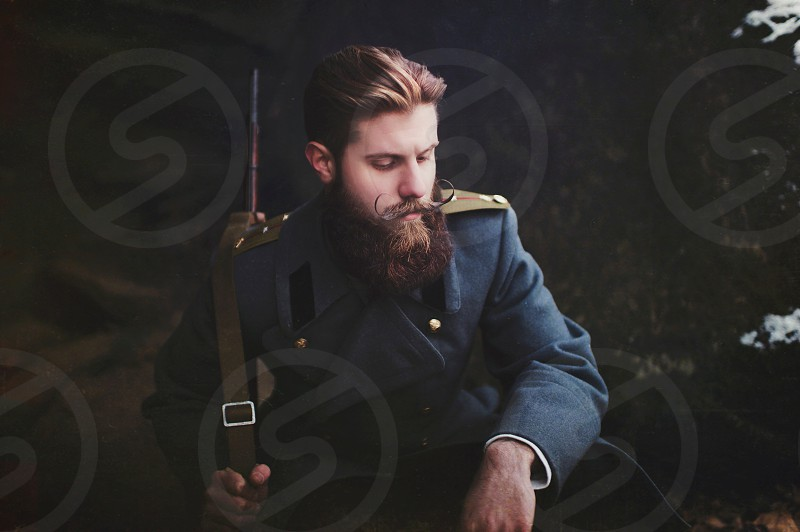 man in blue coat  photo