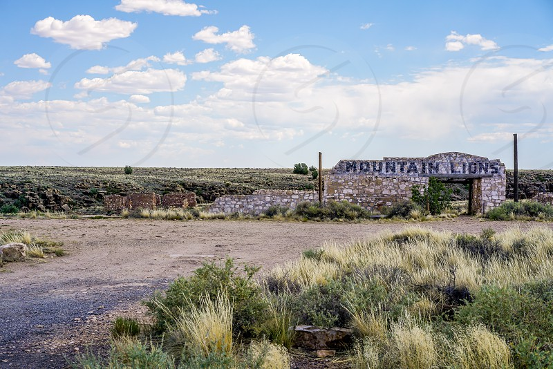 A ghost town in the Arizona desert abandoned for over thirty years. It was once a thriving town on a historic route and now it sits in ruins crumbling from nature's wrath. photo