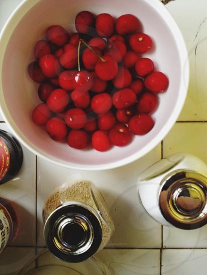red raspberry on white bowl photo