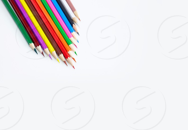 Art and drawing creative concepts of colorful crayon pencils on white background aligned with triangle shape with copy space. Top view Close-up For banner design. photo