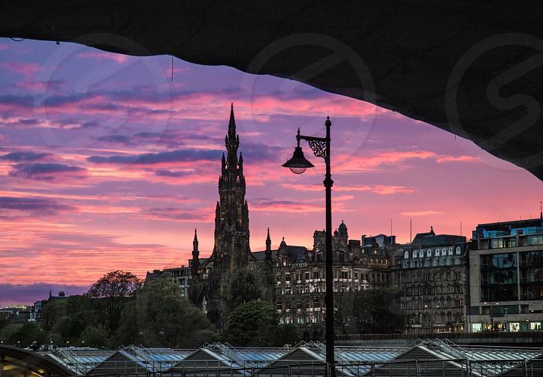 Dramatic Edinburgh Scotland sunset of pinks and blues and purples photo