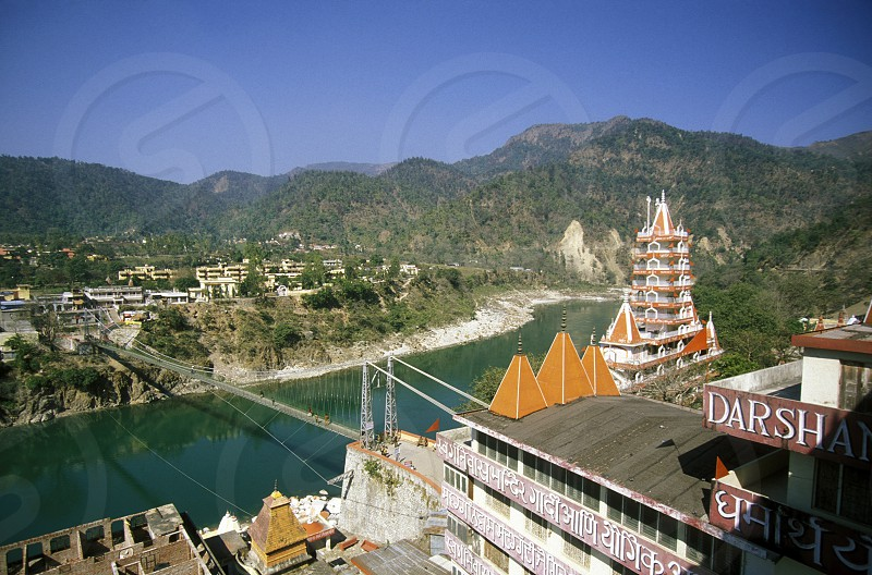the Ganges River in the town of Rishikesh in the Province Uttar Pradesh in India. photo