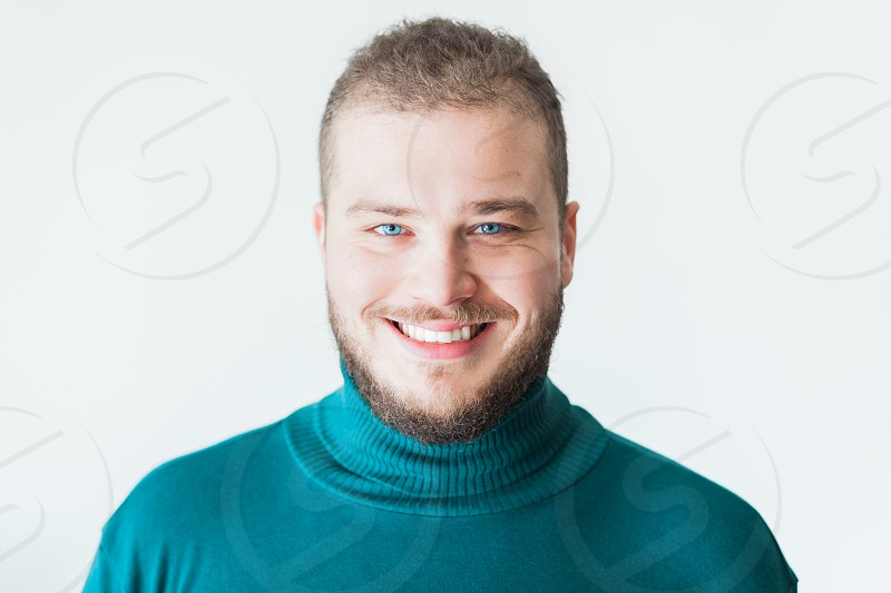 Portrait of a young bearded man smiling photo