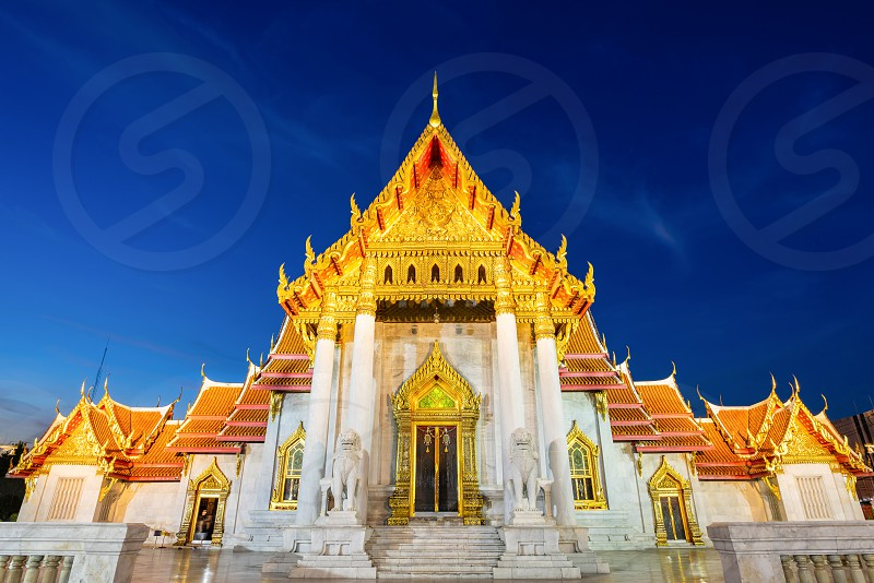Thai Marble Temple (Wat Benchamabophit Dusitvanaram) night scene at dusk in Bangkok Thailand photo
