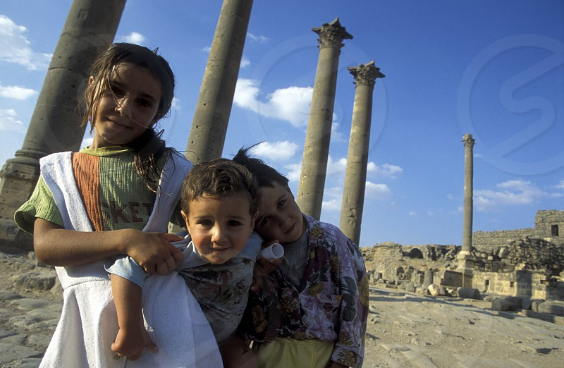 the ruins in the town of Bosra in Syria in the middle east photo