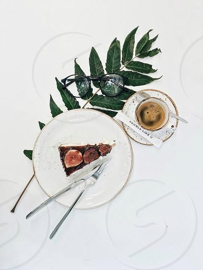 Coffee table glasses cup coffee shop white minimalism dessert plates linch breakfast break green leaf photo
