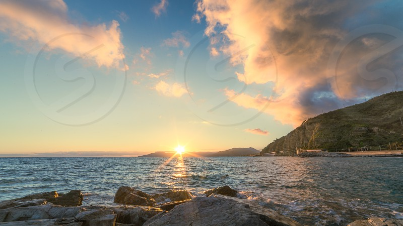 Sunset over Tigullio gulf from Sestri Levante to Portofino Italy photo