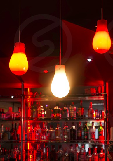 Lamps in a night bar. Red lights photo