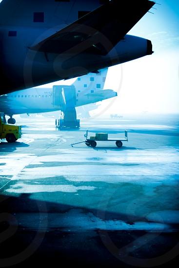 airplanes runway tarmac ice winter boarding photo