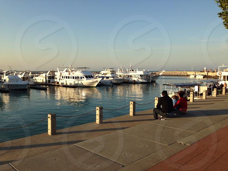 LisAm watching the sun goes down happy family corniche marina boats jetty photo