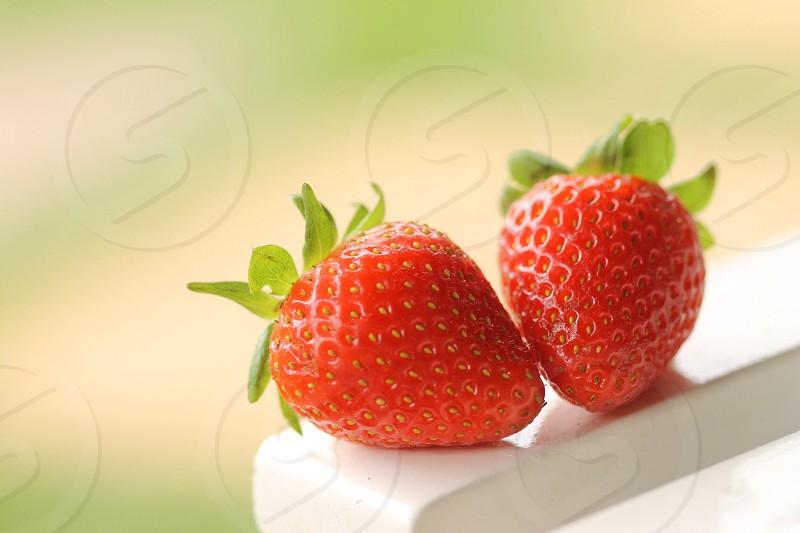 2 red strawberries photo