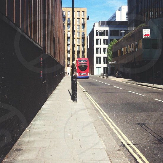 red double Decker bus on road photo