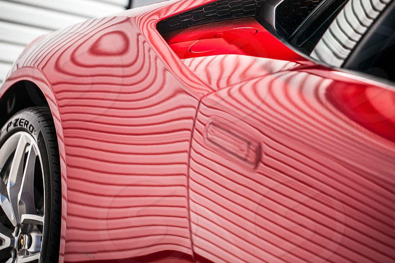 Abstract detail closeup macro fender tire car exotic race shapes contract Lamborghini Huracan red stripes lines vent spoiler garage vehicle window trunk lid mirror metal steel graceful sexy attractive fast powerful loud horsepower engine motor luxury exclusive expensive door photo