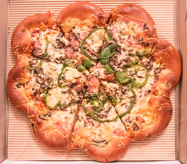 Delicious Tasty Pizza In A Cardboard Box photo